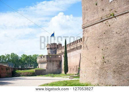 View of Castel sant angelo in Rome with european union flag on tower