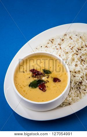 Whole Yellow Lentil with Rice, dal tadka and jeera rice, Indian Dish, cooked rice and cooked Arhar or Toor dal (Pigeon Pea) ** Note: Visible grain at 100%, best at smaller sizes