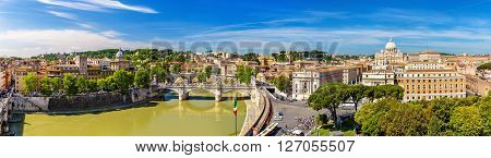View of the Tiber river and the St. Peter Basilica in Rome - Italy