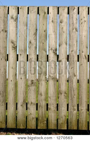 Close Vertical View Of A Wooden Perimeter Fence.