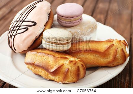 Plate of cakes on wooden background
