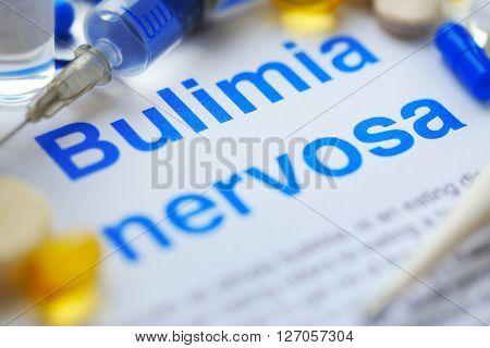 Medicines and Bulimia diagnosis written on paper closeup
