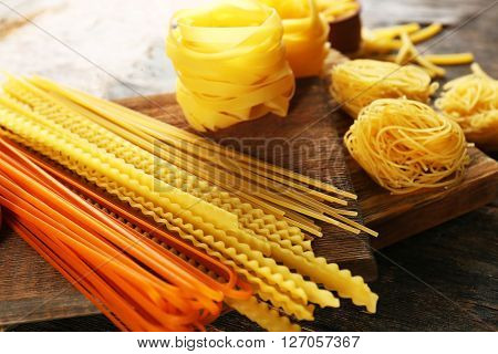 Uncooked pasta on cutting board, closeup