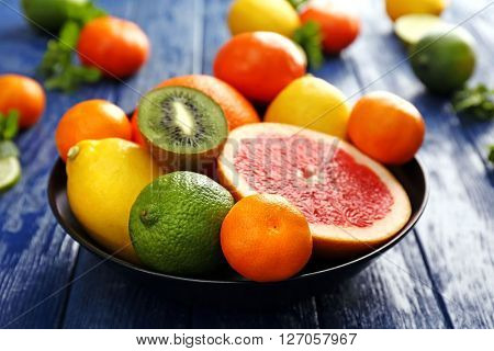 Juicy composition of tropical fruits in a bowl, close up