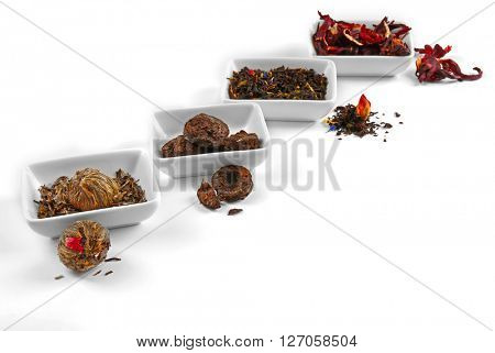 Variety of tea leaves, isolated on white