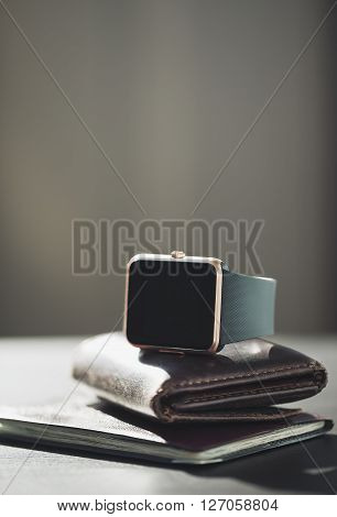Smart Watch, Wallet With Monet, Passport On The Table