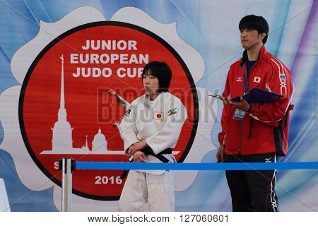 ST. PETERSBURG, RUSSIA - APRIL 16, 2016: Mai Umekita of Japan (left) against the banner of tournament during the Junior European Judo Cup. Mai Umekita won first place in the category -48 kg