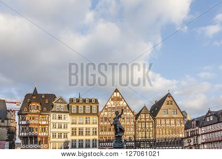 FRANKFURT GERMAY - FEB 22 2015: statue Lady Justice with sword and scale stands in front of half timbered houses at the Roemerberg in Frankfurt. The Roemeberg is the central place in Frankfurt.