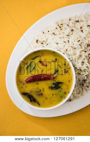 Whole Yellow Lentil with Rice, dal tadka and jeera rice, Indian Dish, cooked rice and cooked Arhar or Toor dal (Pigeon Pea)