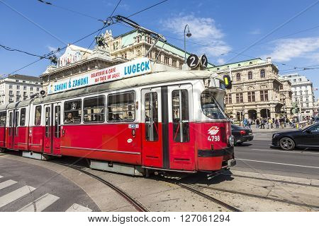 People In Front Of Vienna State Opera House Ride The Streetcar