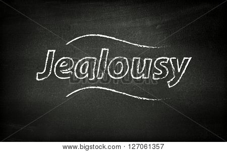 Jealousy written on blackboard