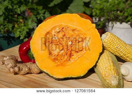 Organic Pumpkin Squash With Fresh Vegetables: Corn, Red Peppers, Scallion, And Ginger
