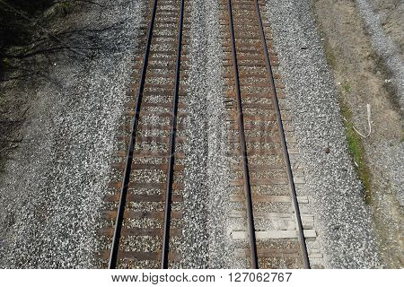 a view from above two sets of railroad tracks