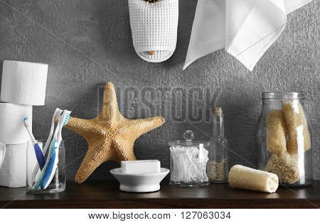 Bath accessories on grey wall background