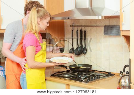 Couple Woman And Man Frying Breaded Chicken Cutlet
