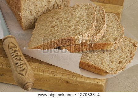 Slices of wholemeal bread with a knife.