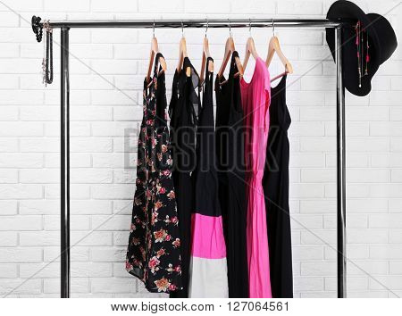 Collection of female clothes hanging on a rack
