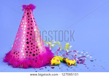 Funny party hat on blue background