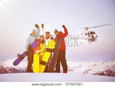 Snowboarders on top of the Mountain with Heli Ski