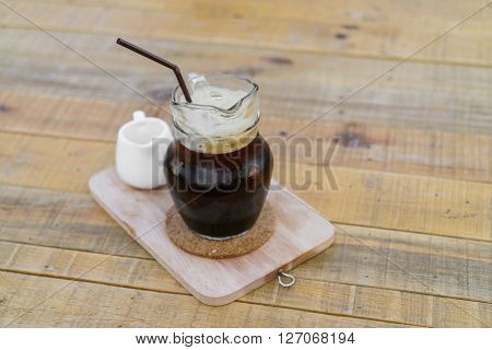 Ice cold coffee on a wooden table