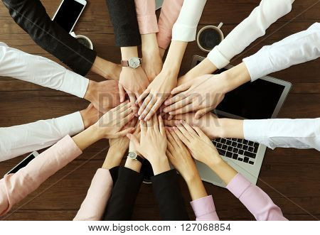 Teamwork concept. Business people hands over wooden table, top view