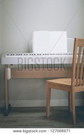 Piano gray background Cream. Wooden oak Corner taken right-front