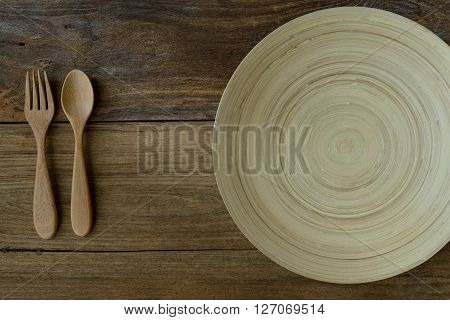 The Brown Wooden Bowl On A Rustic Table With Wooden Spoon And Fork ,wooden Background
