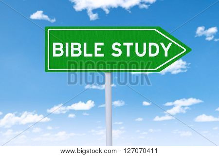 Road sign with green color and a text of bible study shot under blue sky