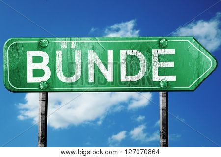 Bunde road sign, on a blue sky background
