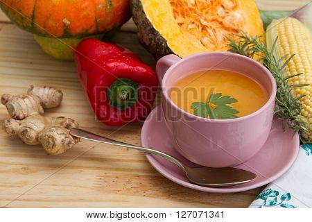 Squash Soup And Organic Pumpkin Fresh Vegetables: Corn, Red Peppers, Scallion, Ginger And Rosemary