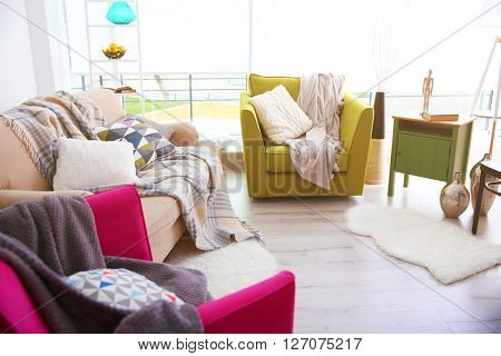 Modern living room design with sofa and armchairs