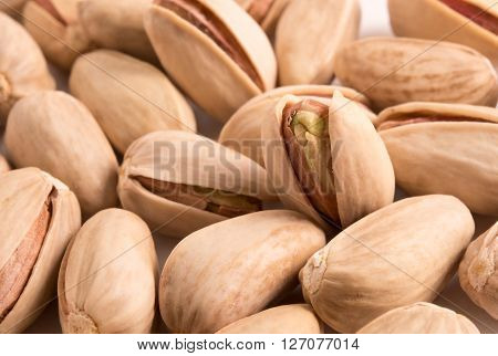 close up of Pistachio nuts as a background