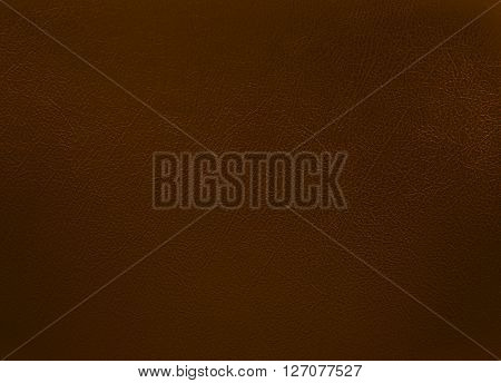 close up brown colored leather texture background.