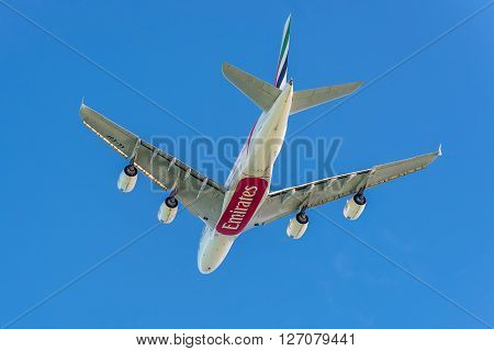 Plaisance Mauritius - December 27 2015: The Airbus A380-841 aircraft of Emirates Airlines takeoff from the Sir Seewoosagur Ramgoolam International Airport (MRU) Plaisance Mauritius and flying to Dubai - International (DXB) United Arab Emirates. Airbus A38