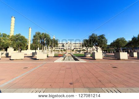 Barcelona, Spain - November 12, 2015: Barcelona Olympic Stadium and olympic park (Anella Olimpica). The park was the main site for the 1992 Summer Olympics. The promenade connects Placa d Europa and the olympic stadium.