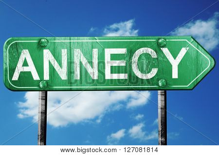 annecy road sign, on a blue sky background