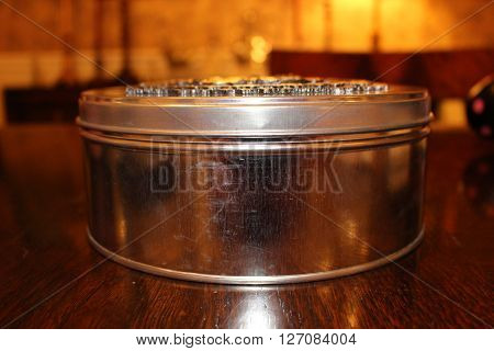Silver Round Tin Box side view on table