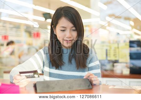 Woman using tablet pc for online payment