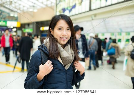 Woman in train station