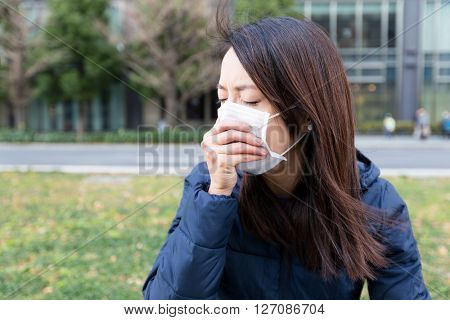Woman with face mask at outdoor park