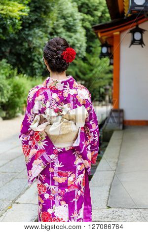 Back view of woman with kimono