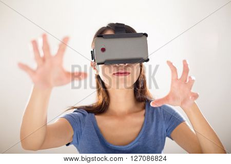 Young Woman experience with virtual reality device