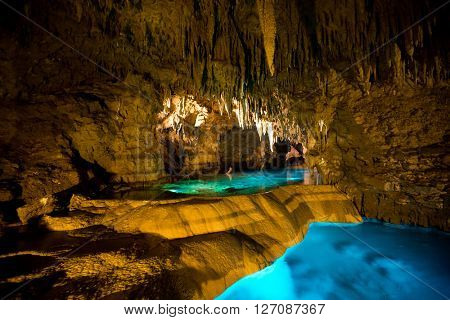 Cave with many stalactites and lake