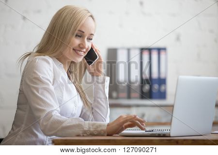 Happy Businesswoman Working In Her Office