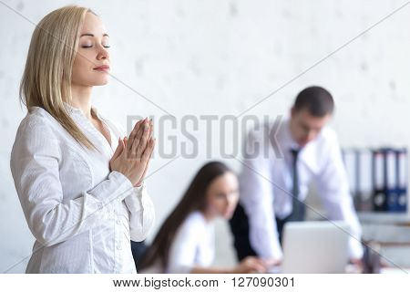 Corporate Woman Meditating At Work