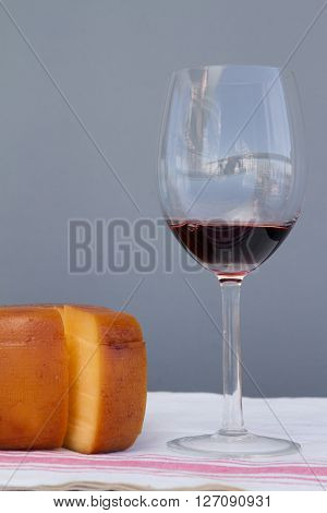 Cheese Wheel And Glass Of Malbec Wine