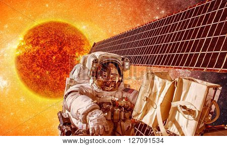 Spacecraft and astronauts in space on background sun star. Elements of this image furnished by NASA.