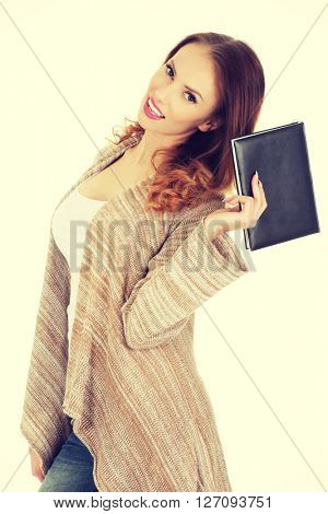 Woman with a notebook.