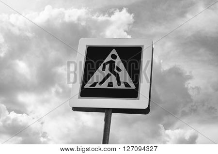 A pedestrian crossing sign. Photoof traffic sign on a metal pole.