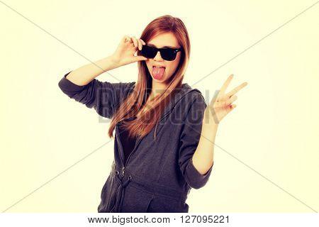 Young teenage woman wearing sunglasses